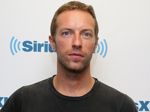"Chris Martin Says He's ""Happy to Be Alive"" After Splitting From Gwyneth Paltrow"