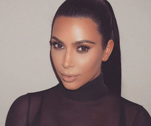 Kim Kardashian Teases Family Holiday Card with Saint and North West