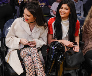 Kendall and Kylie Jenner Sport Crazy Thigh-High Boots at Lakers Game -- See…