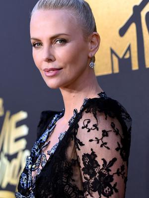 "Charlize Theron Thanks Her ""Own Little Furiosa,"" Daughter August, During MTV Movie Award Speech"