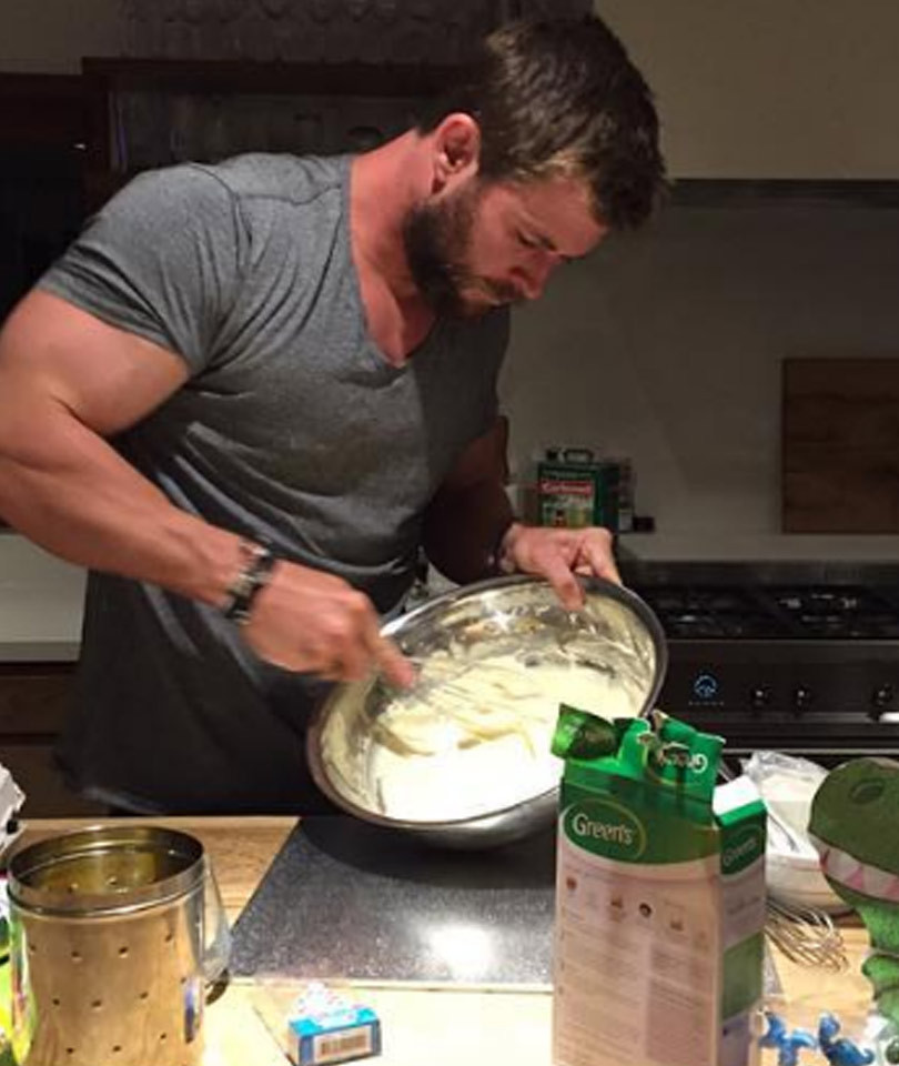 This Photo of Chris Hemsworth Baking a Cake for His Daughter Is Too Many Things