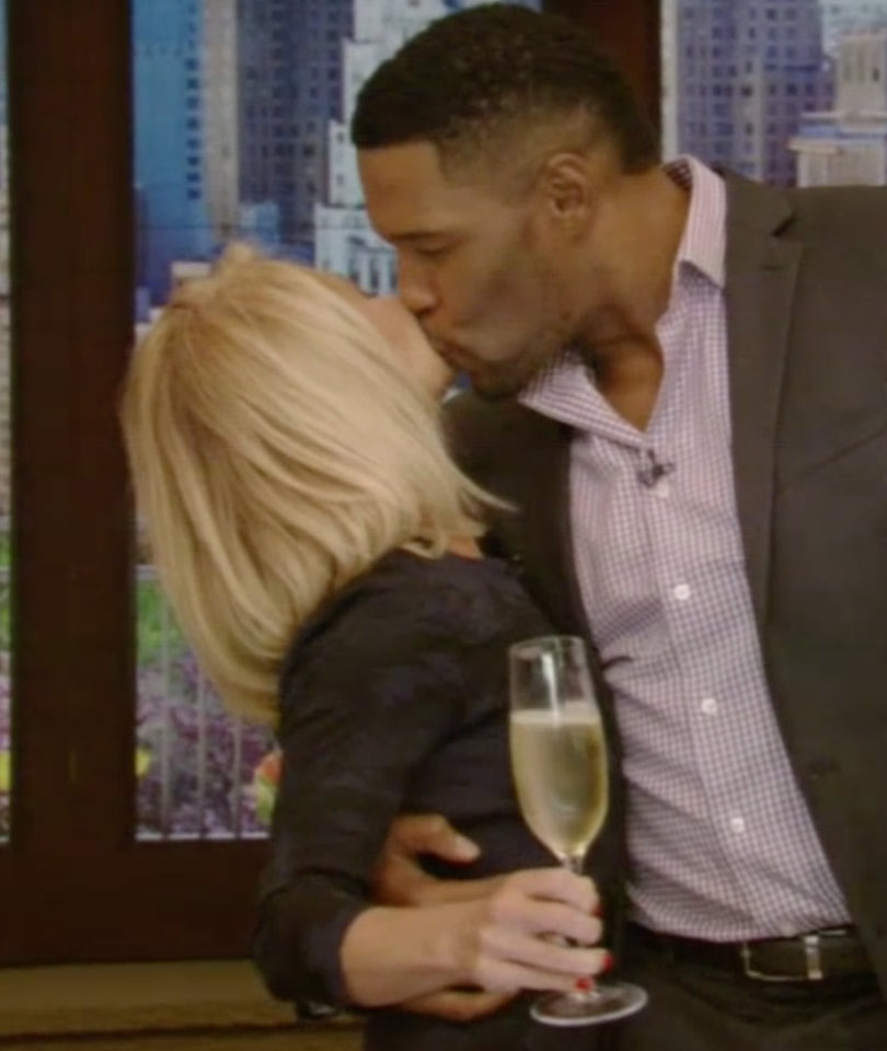 """Michael Strahan Kisses Kelly Ripa Goodbye on His Final Episode of """"Live with…"""