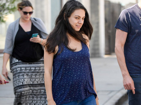 Mila Kunis Shows Off Her Baby Bump For the First Time