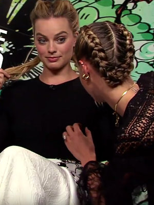 Cara Delevingne Shows Off Nipple-Finding Skills on Margot Robbie, Reporter