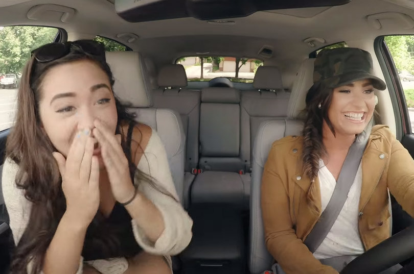 "Demi Lovato Goes Undercover as Lyft Driver, Pokes Fun at Her ""Weird"" Chin"