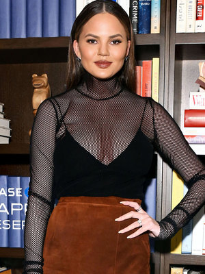 Chrissy Teigen Shows Some Cleavage In Daring Mesh Top