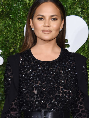 Chrissy Teigen Sparkles In Sheer Black Midi In NYC