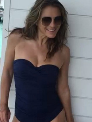 Elizabeth Hurley Shows Off Her Killer Beach Bod in Navy One-Piece
