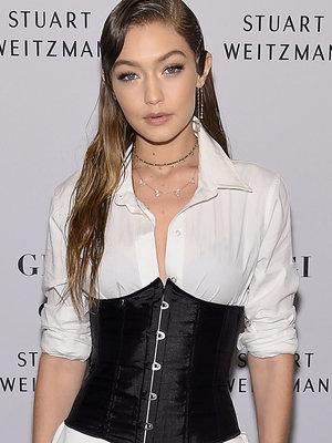 Gigi Hadid Rocks Wet Hair, Corset at Stuart Weitzman Boot Launch