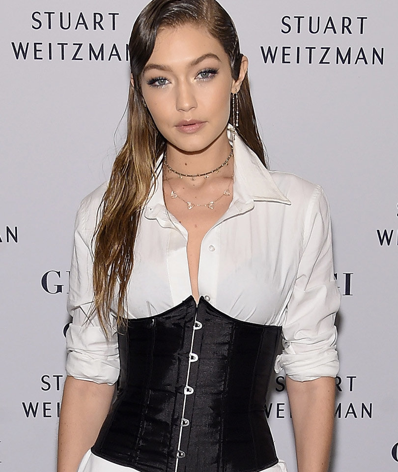 Gigi Hadid Rocks Wet Hair, Corset at Stuart Weitzman Boot…