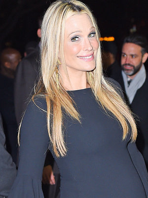 Molly Sims Flaunts Growing Baby Bump During Date Night In NYC