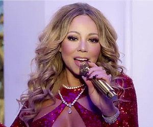 See Mariah Carey's Festive 'Here Comes Santa Claus' Featuring Bryan Tanaka (Video)