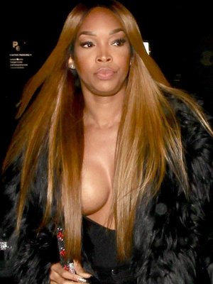 Malika Haqq Risks a Wardrobe Malfunction In Deep Plunging Top (Photo)
