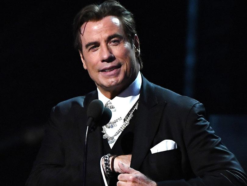 John Travolta Gives Us 'Adele Dazeem' Flashback With Awkward Grammys Teleprompter Moment (Video)