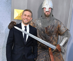Charlie Hunnam Stares Down a Sword at 'King Arthur' Premiere