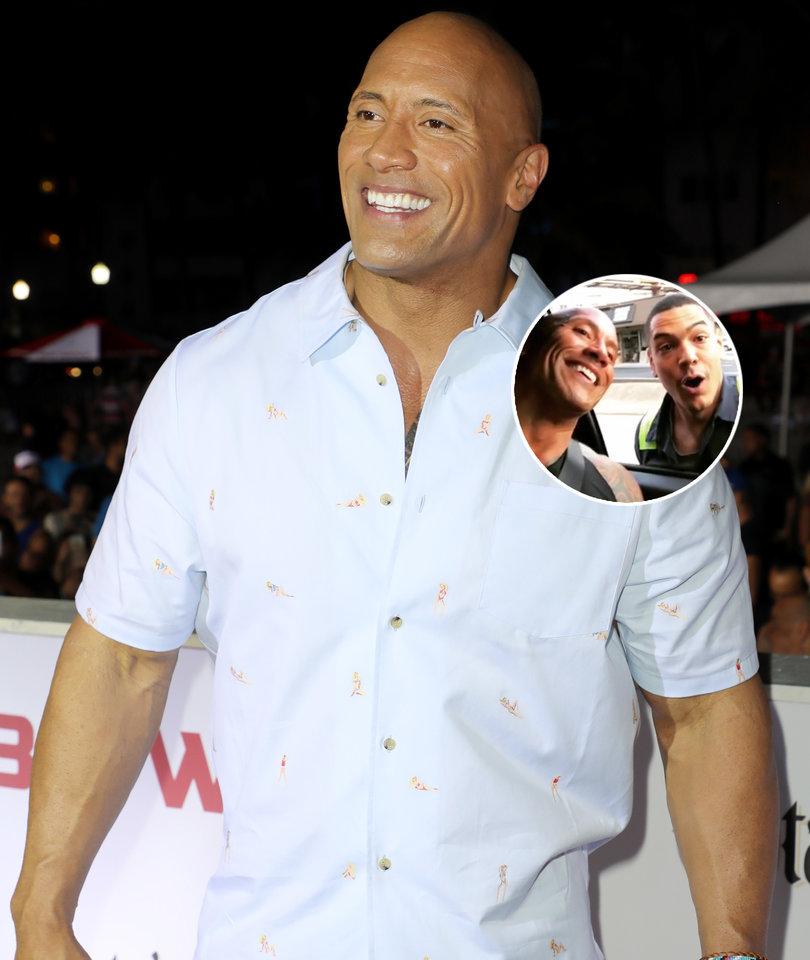 The Rock Holds Up Traffic to Take Photo With Fan: 'You're Gonna Get Hit'