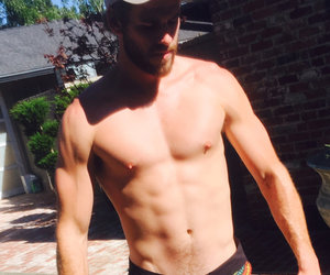Liam Hemsworth Flexes In the Tiniest Shorts Imaginable
