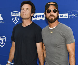 Bateman and Theroux Walk Hand-In-Hand Down Blue Carpet