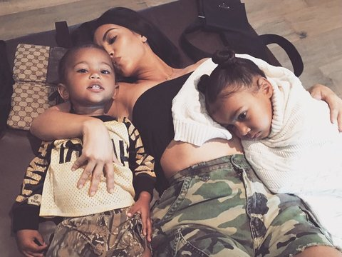 Kim Kardashian Cuddles with Saint and North West In New Selfie