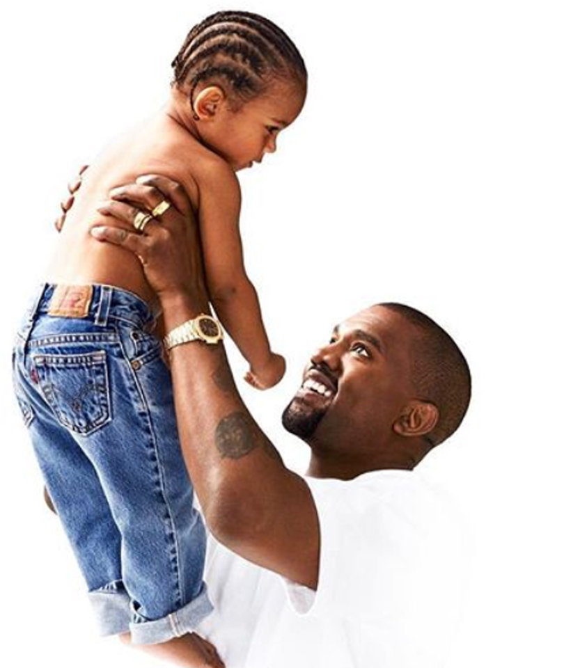 Saint and Kanye West Share Father-Son Moment In Kardashian Holiday Card