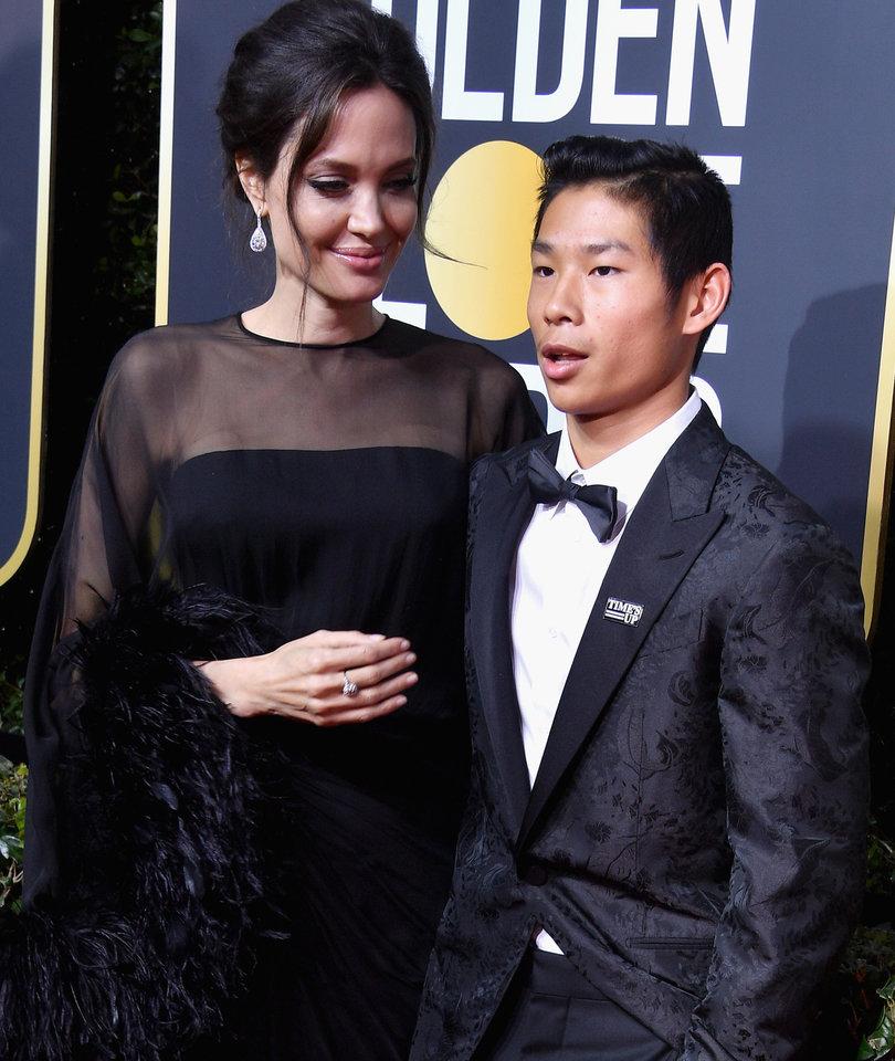 Angelina Jolie Walks Golden Globes Carpet with Son Pax