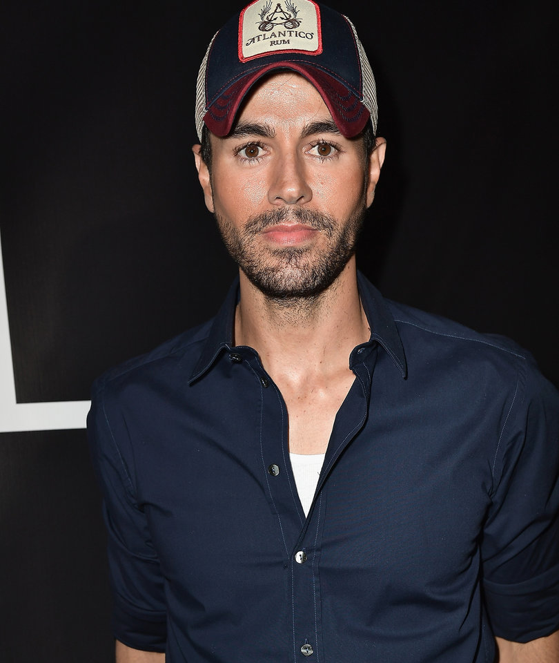 Enrique Iglesias Shares First Photo of One of His Twins with Anna Kournikova
