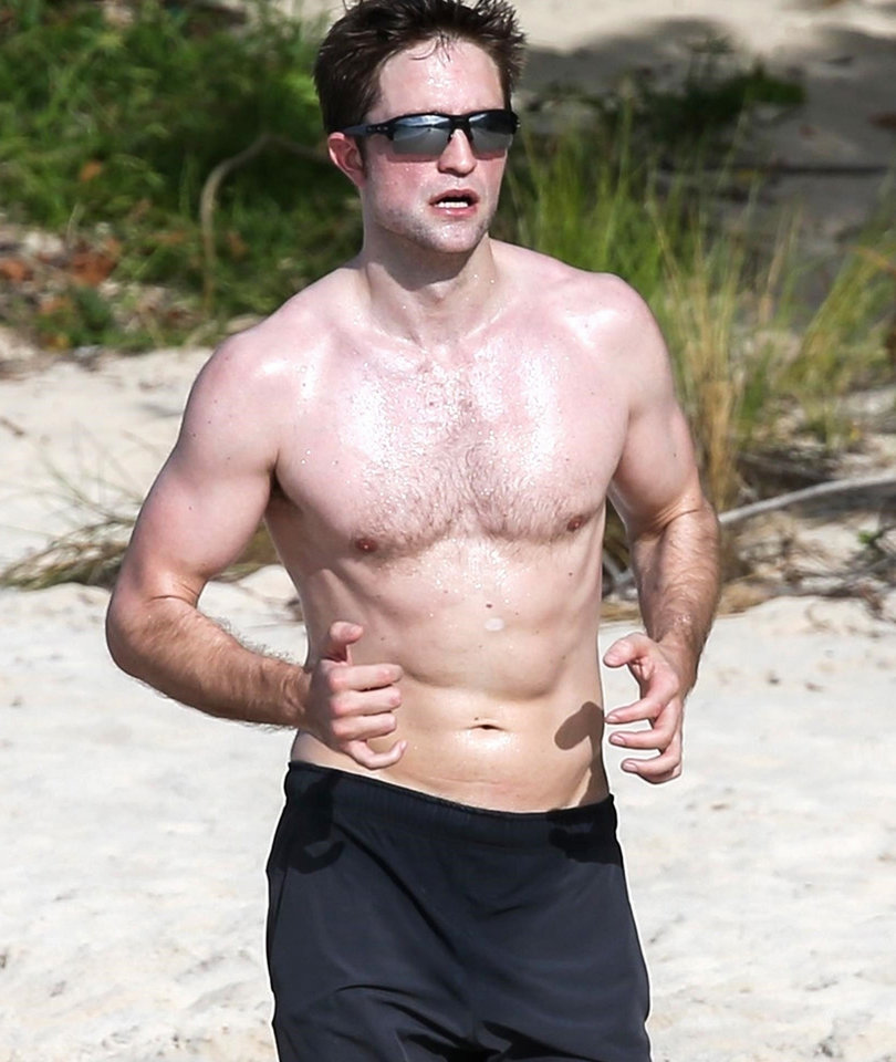Robert Pattinson Shows Off Abs on the Beach in Antigua